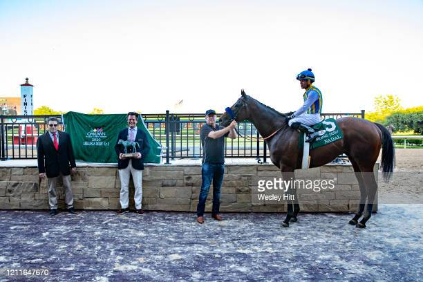 Nadal with Jockey Joel Rosario onboard and trainer Bob Baffert in the winners circle after winning the The Arkansas Derby during the Covid19 Pandemic...