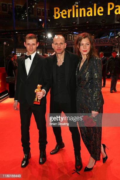 Nadav Lapid winner of the Golden Bear for Best Film for Synonymes poses at the red carpet with Tom Mercier and Louise Chevillotte after the closing...