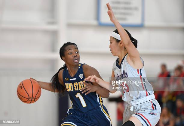 Naddiyah Cross of the Kent State Golden Flashes dribbles against Honoka Ikematsu of the Robert Morris Colonials in the second half during the game at...