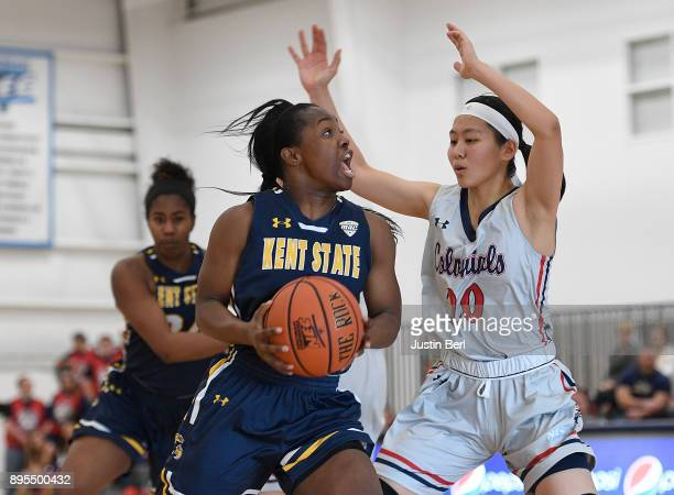 Naddiyah Cross of the Kent State Golden Flashes drives to the basket against Honoka Ikematsu of the Robert Morris Colonials in the second half during...
