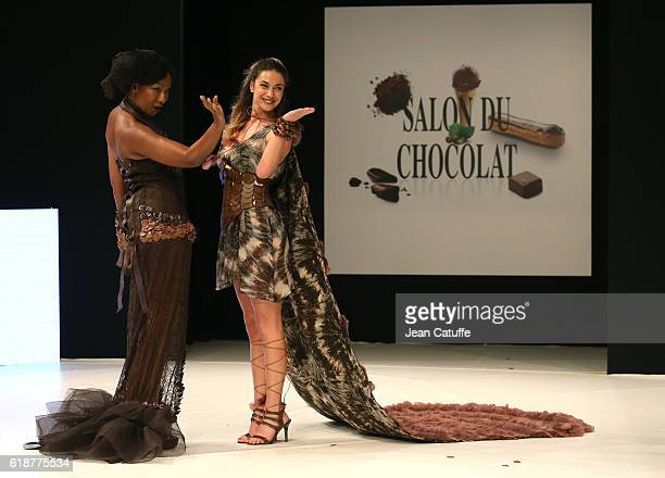 Nadege BeaussonDiagne and Clio Pajczer walk the runway during the Chocolate Fashion Show as part of Salon du Chocolat Paris 2016 at Parc des...