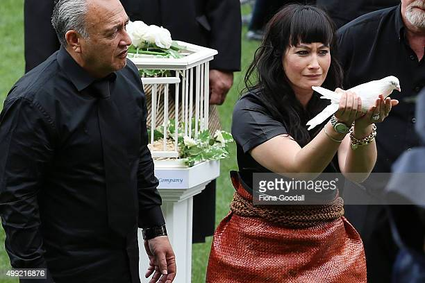 Nadene Lomu releases a dove as Jonah's casket leaves the field at the Public Memorial for Jonah Lomu at Eden Park on November 30 2015 in Auckland New...