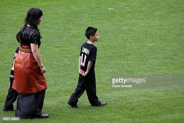 Nadene Lomu walks with her sons after the hearse as it leaves the service at the Public Memorial for Jonah Lomu at Eden Park on November 30 2015 in...
