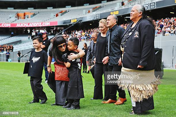 Nadene Lomu widow of New Zealand All Blacks rugby legend Jonah Lomu walks onto Eden Park with her two sons Brayley and Dhyreille her parents Lois and...