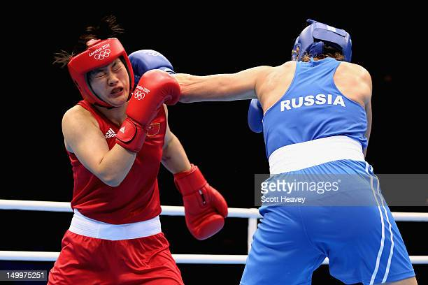 Nadezda Torlopova of Russia in action against Jinzi Li of China during the Women's Middle Boxing semifinals on Day 12 of the London 2012 Olympic...