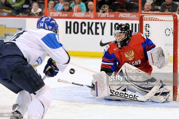 Nadezhda Alexandrova of Team Russia gets down to stop the puck on a shot by Niina Makinen of Team Finland during the IIHF Womens World Championship...