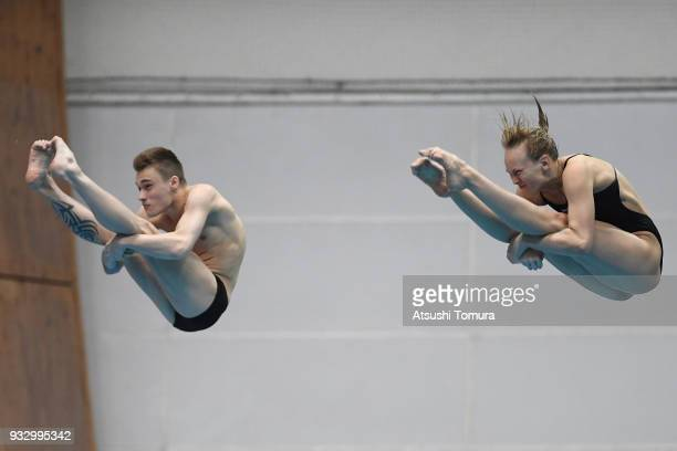 Nadezhda Bazhina and Nikita Shleikher of Russia compete in the Mixed 3m Synchro Springboard final during day three of the FINA Diving World Series...