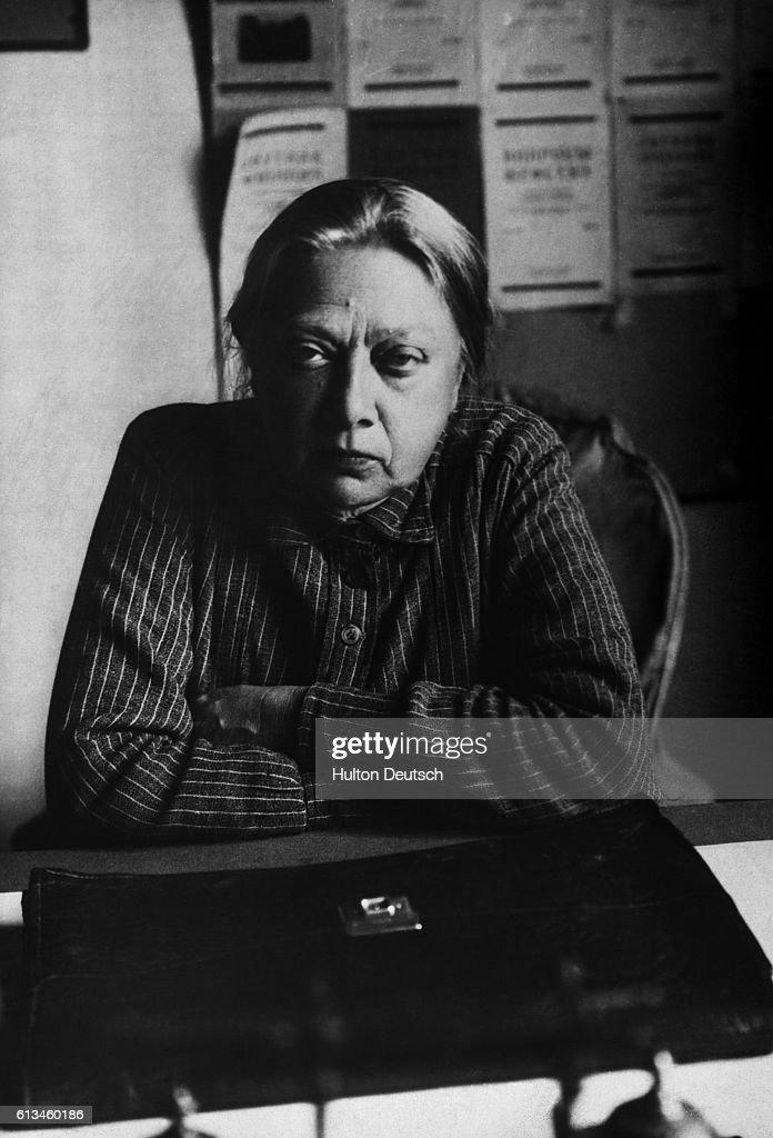 Nadezhda Konstantinova Krupskaya, wife of Vladimir Lenin, sits at her desk.