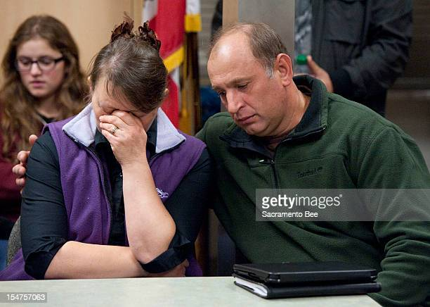 Nadezhda Oliferchik is comforted by her husband Vyacheslav on Thursday, October 25 in Sacramento, California, as they attend a press conference for...