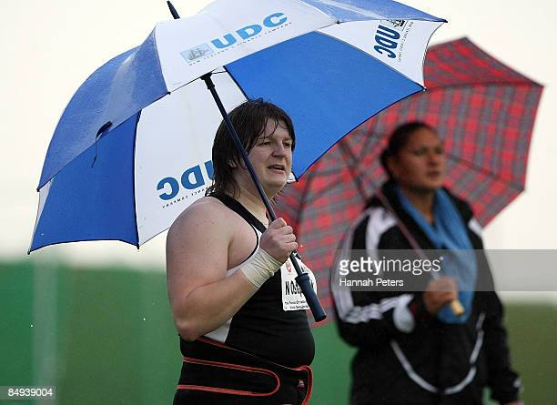 Nadezhda Ostapchuk of Belarus looks on with Valerie Vili of New Zealand during the Women's Shot Put Final during the 2009 Black Singlet Invitational...