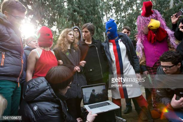 Nadezhda Tolokonnikova Maria Alyokhina and two masked activists of the punk group Pussy Riot show their new video during a news conference held...