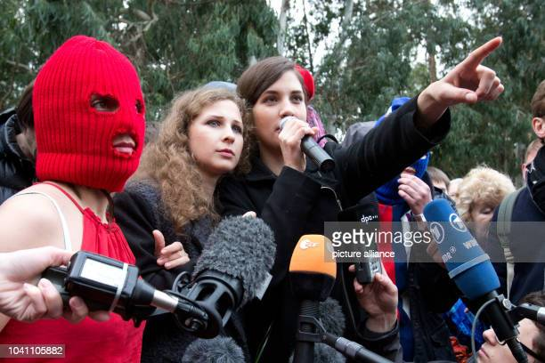 Nadezhda Tolokonnikova Maria Alyokhina and two masked activists of the punk group Pussy Riot speak during a news conference held outside a hotel in a...