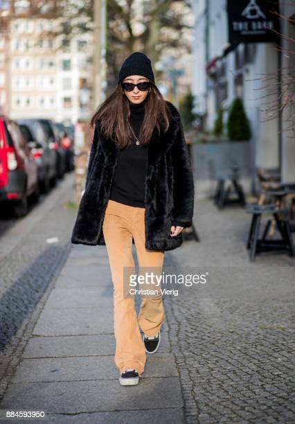Nadia Ali wearing a black beanie Drykorn black sunglasses Mango black jacket Zara black turtleneck Repeat Cashmere beige pants The Cords black Vans...