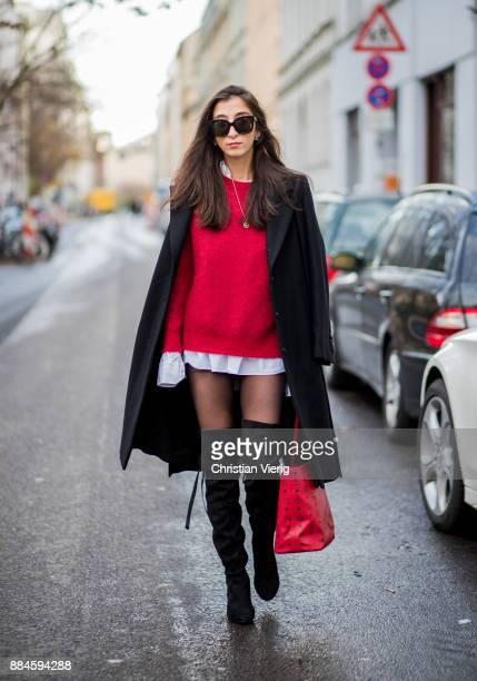 Nadia Ali wearing black Celine sunglasses Chanel earrings red knit Drykorn white boyfriend button shirt Van Laack black overknee boots Mint Berry red...