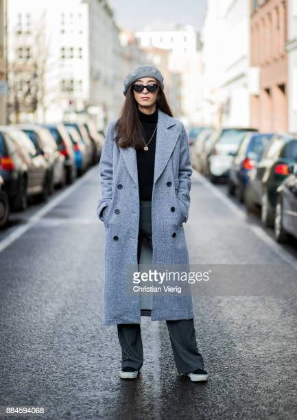 Nadia Ali wearing grey beret Zara Mango sunglasses a grey coat Mint Berry black turtleneck Repeat Cashmere grey pants Zara black Vans sneakers Chanel...