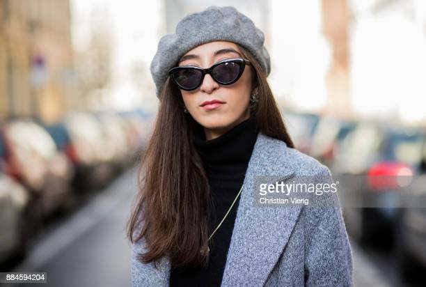 Nadia Ali wearing grey beret Zara Mango sunglasses a grey coat Mint Berry black turtleneck Repeat Cashmere grey pants Zara black Vans sneakers Chanel...