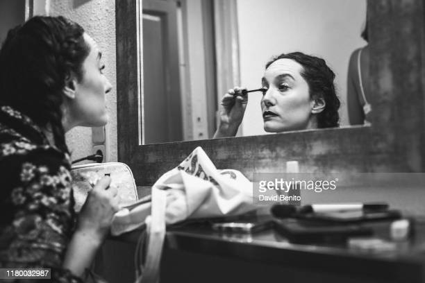 Nadia Alonso puts on makeup in the dressing room of Teatro Cofidis Alcazar on September 15, 2019 in Madrid, Spain.