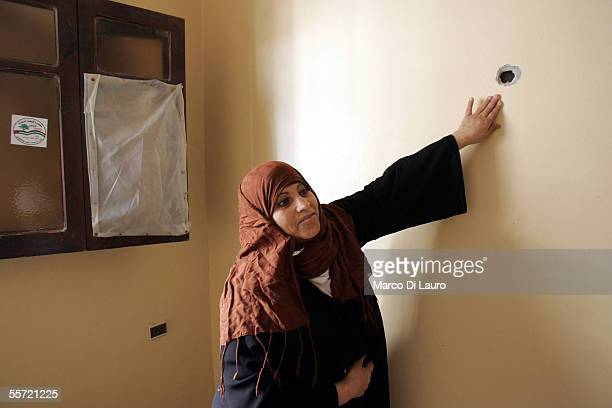 Nadia AlShair 40yearsold points to a bullet hole in a wall of her house on September 19 2005 in Rafah refugee camp Gaza Strip Nadia and her husband...