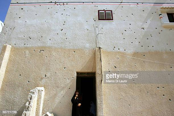 Nadia AlShair 40yearsold stands in front of her bullet hole scarred house on September 19 2005 in Rafah refugee camp Gaza Strip Nadia and her husband...