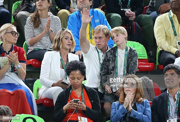 Nadia Comaneci, her husband Bart Conner and their son Dylan Conner attend the Women's Individual All-Around Final on day 6 of the Rio 2016 Olympic...