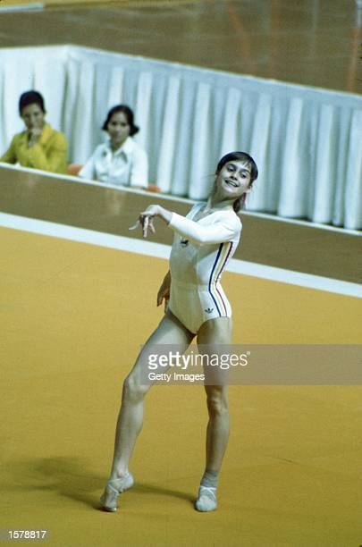 Nadia Comaneci of Romania performs the floor excercise during the 1976 Summer Olympic Games in Montreal Quebec Canada Mandatory Credit Allsport...