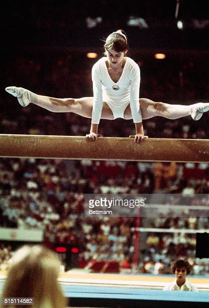 Nadia Comaneci, the 14 year old gymnastic sensation from Romania, demonstrates her balance during her routine on the balance beam at the 1976 Summer...
