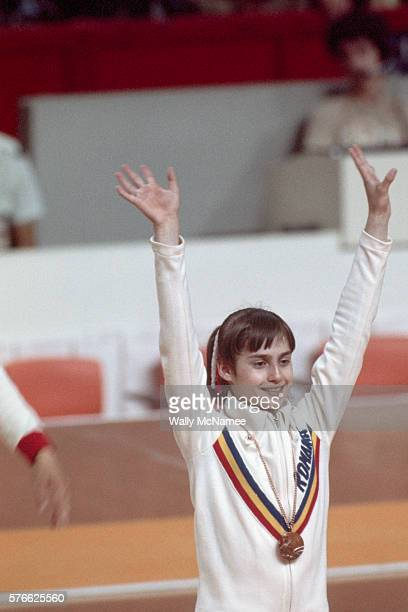 Nadia Comaneci the first Olympic gymnast to score a perfect 10 wears one of the many gold medals she won at the 1976 Olympic Games