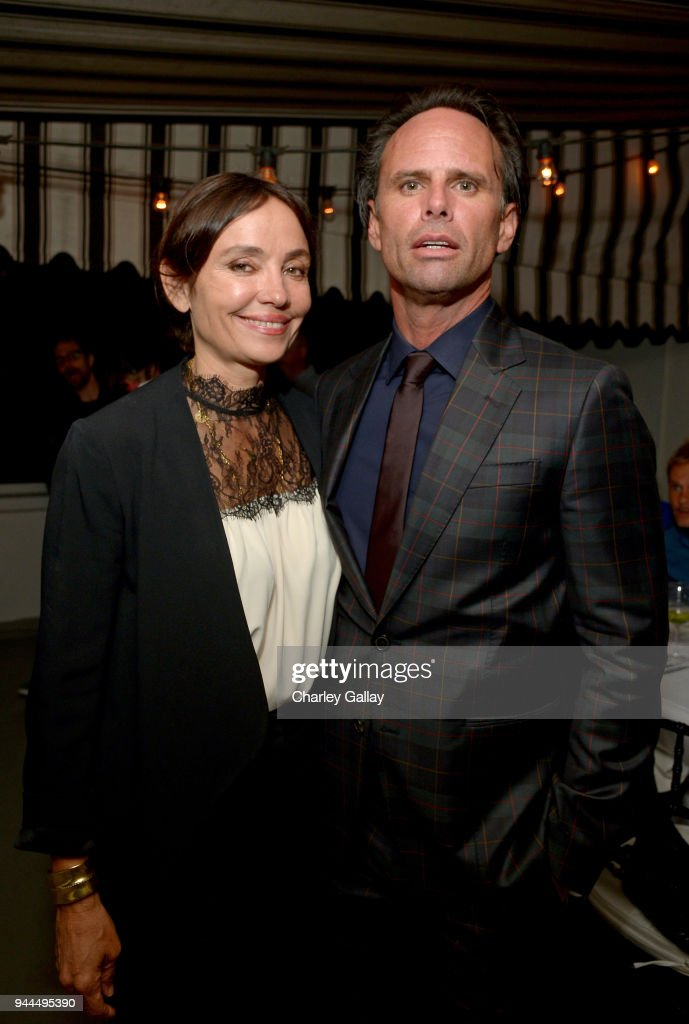Nadia Conners (L) and Walton Goggins, wearing Paul Smith, attend Paul Smith's intimate dinner with Gary Oldman at Chateau Marmont on April 10, 2018 in Los Angeles, California.