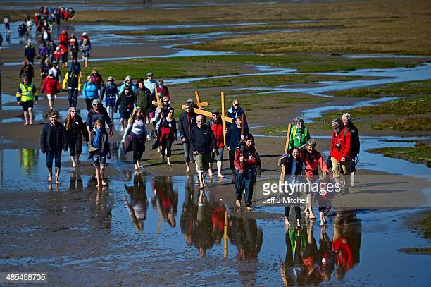 Nadia Coppola 16 and Johanna Hanson 5 lead pilgrims walking with crosses as the Northern Cross pilgrimage undertakes its final leg of the journey to...
