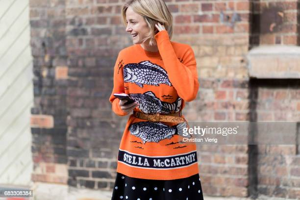 Nadia Fairfax wearing an orange Stella McCartney sweater Azzedine Alaia skirt sneaker at day 2 during MercedesBenz Fashion Week Resort 18 Collections...