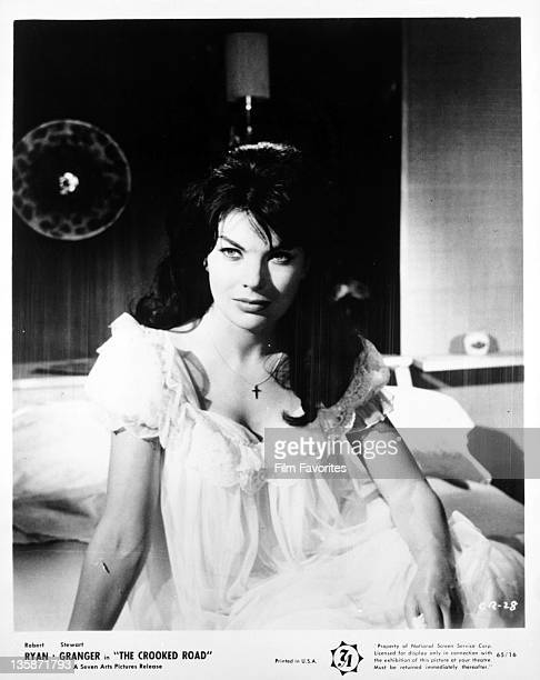 Nadia Gray sitting on bed in a scene from the film 'The Crooked Road' 1965