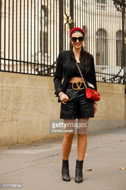 Nadia Hartzer Austin wearing Valenciaga bag and shoes Heroine red clutch and Burberry mini clutch outside the Elie Saab show during Womenswear...