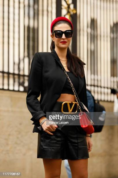 Nadia Hartzer Austin wearing Valenciaga bag and shoes, Heroine red clutch and Burberry mini clutch outside the Elie Saab show during Womenswear...