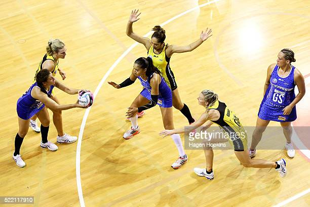 Nadia Loveday of the Mystics attempts to pass to teammate Maria Tutaia while under pressure from Katrina Grant and Phoenix Karaka of the Pulse during...