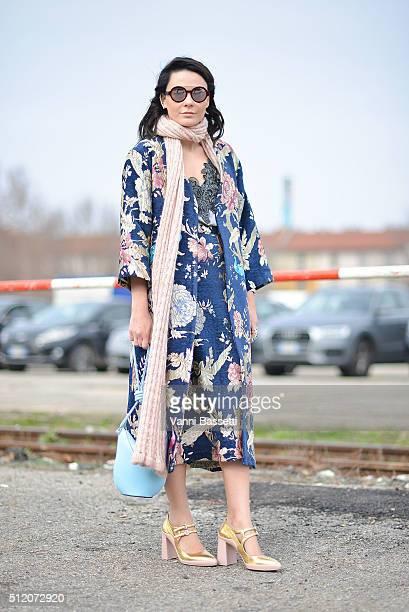 6014c05777 Nadia Missbach poses wearing an Aya coat and dress Loewe bag and Prada  shoes before the