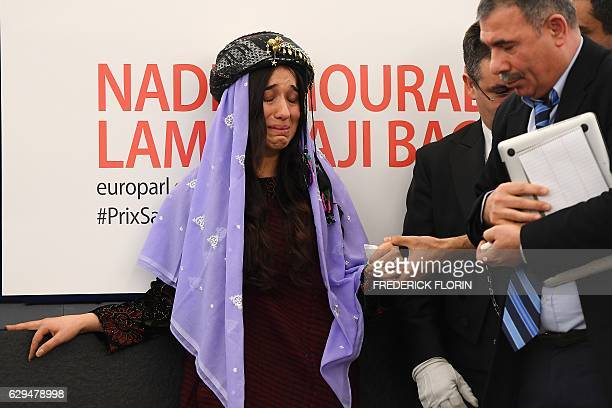 Nadia Murad public advocate for the Yazidi community in Iraq and survivors of sexual enslavement by the Islamic State jihadists reacts after being...