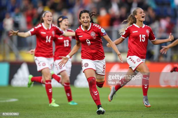 Nadia Nadim and Denmark players celebrate their team's victory during the UEFA Women's Euro 2017 Semi Final match between Denmark and Austria at Rat...