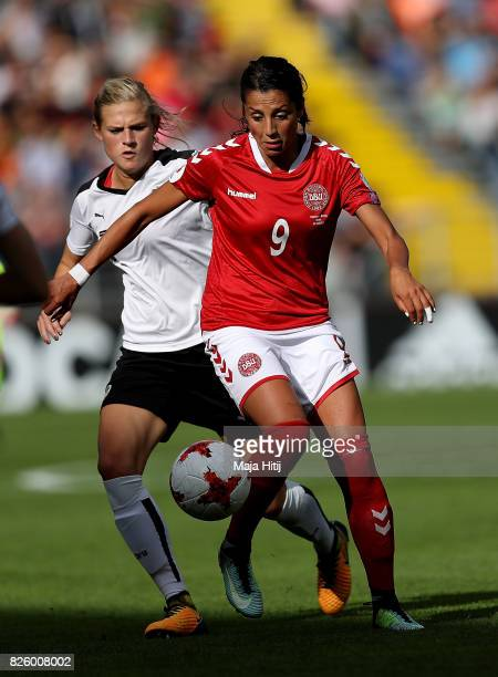Nadia Nadim of Denmark holds off pressure from Carina Wenninger of Austria during the UEFA Women's Euro 2017 Semi Final match between Denmark and...