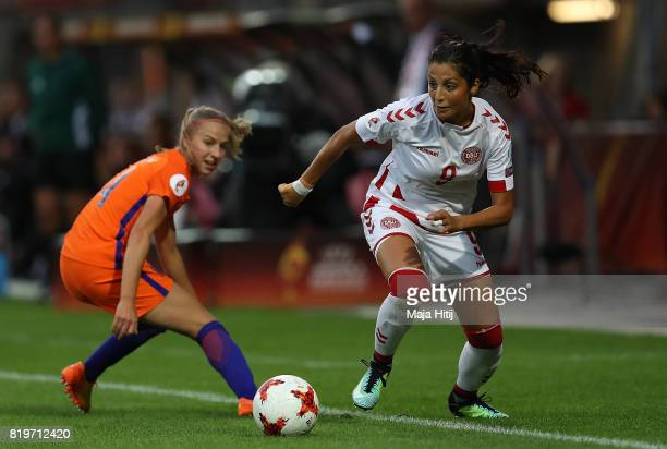 Nadia Nadim of Denmark holds off pressure from Jackie Groenen of The Netherlands during the UEFA Women's Euro 2017 Group A match between Netherlands...