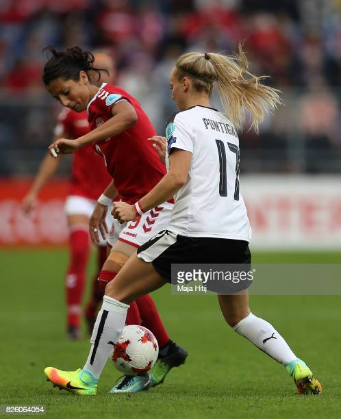 Nadia Nadim of Denmark holds off pressure from Sarah Puntigam of Austria during the UEFA Women's Euro 2017 Semi Final match between Denmark and...