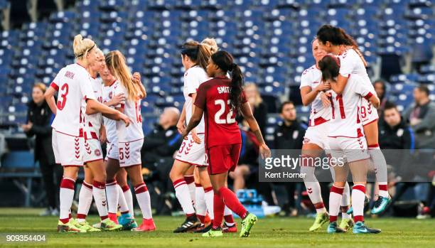 Nadia Nadim of the Danish women's national team is lifted by teammate Katrine Veje after scoring a goal during the first half against the Danish...