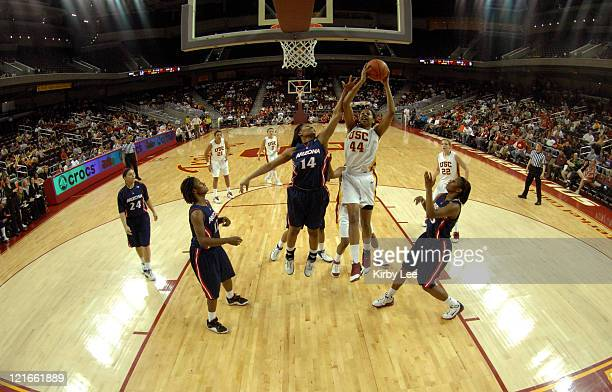 Nadia Parker of USC goes up for a shot against Whitney Fields of Arizona in Pacific10 Conference women's basketball game at the Galen Center in Los...