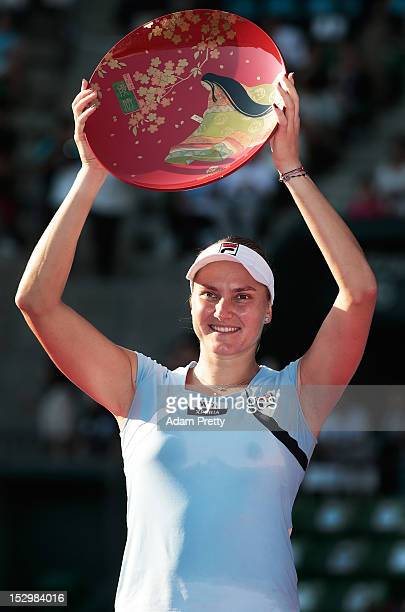 Nadia Petrova of Russia celebrates with the victory plate after over Agnieszka Radwanska of Poland in the womens final during day seven of the Toray...