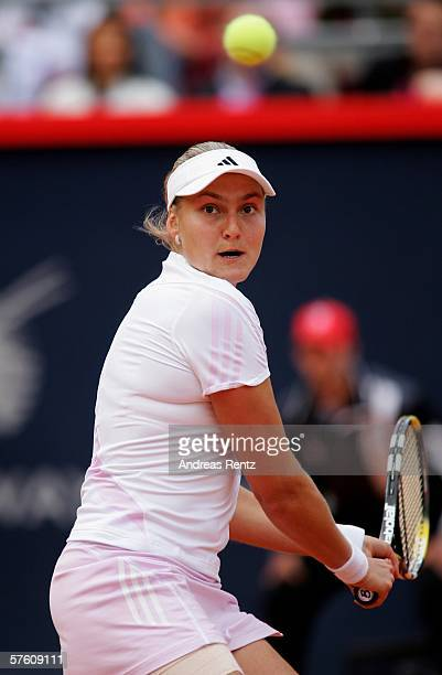 Nadia Petrova of Russia in action against Justine HeninHardenne of Belgium during the seventh day of the Women's Qatar Telecom German Open at the Rot...