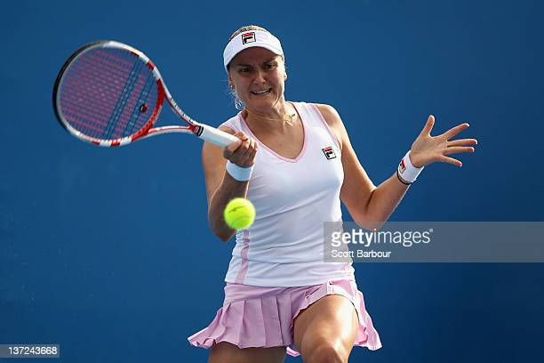 Nadia Petrova of Russia plays a forehand in her first round match against Andrea Hlavackova of the Czech Republic during day two of the 2012...