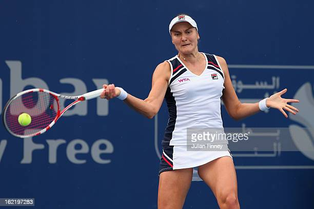 Nadia Petrova of Russia plays a forehand in her match against Carla Suarez Navarro of Spain during day three of the WTA Dubai Duty Free Tennis...