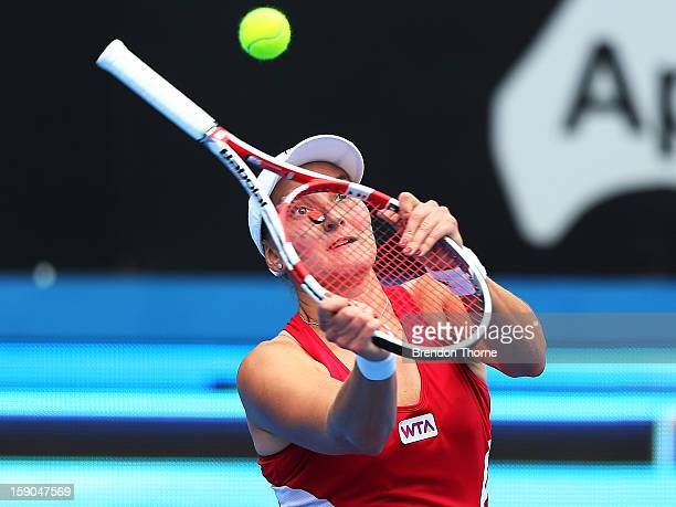 Nadia Petrova of Russia plays an unorthodox shot in her first round match against Roberta Vinci of Italy during day two of the Sydney International...