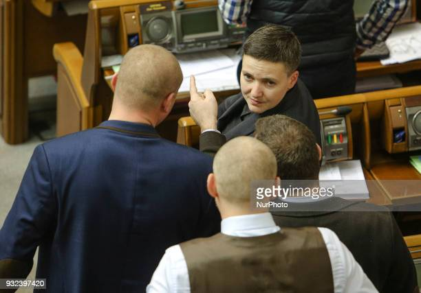 MP Nadia Savchenko talks to her collegues during the session as she came back after been questioned by SSU The session of Ukrainian Parliament in...