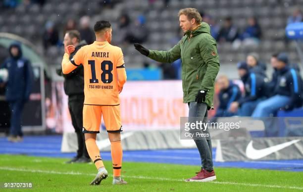 Nadiem Amiri and coach Julian Nagelsmann of the TSG 1899 Hoffenheim during the game between Hertha BSC and TSG Hoffenheim on february 3 2018 in...