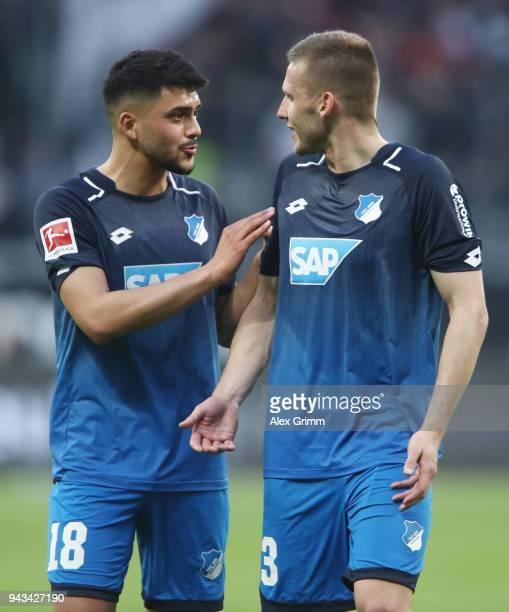 Nadiem Amiri and Pavel Kaderabek of Hoffenheim discuss after the Bundesliga match between Eintracht Frankfurt and TSG 1899 Hoffenheim at...